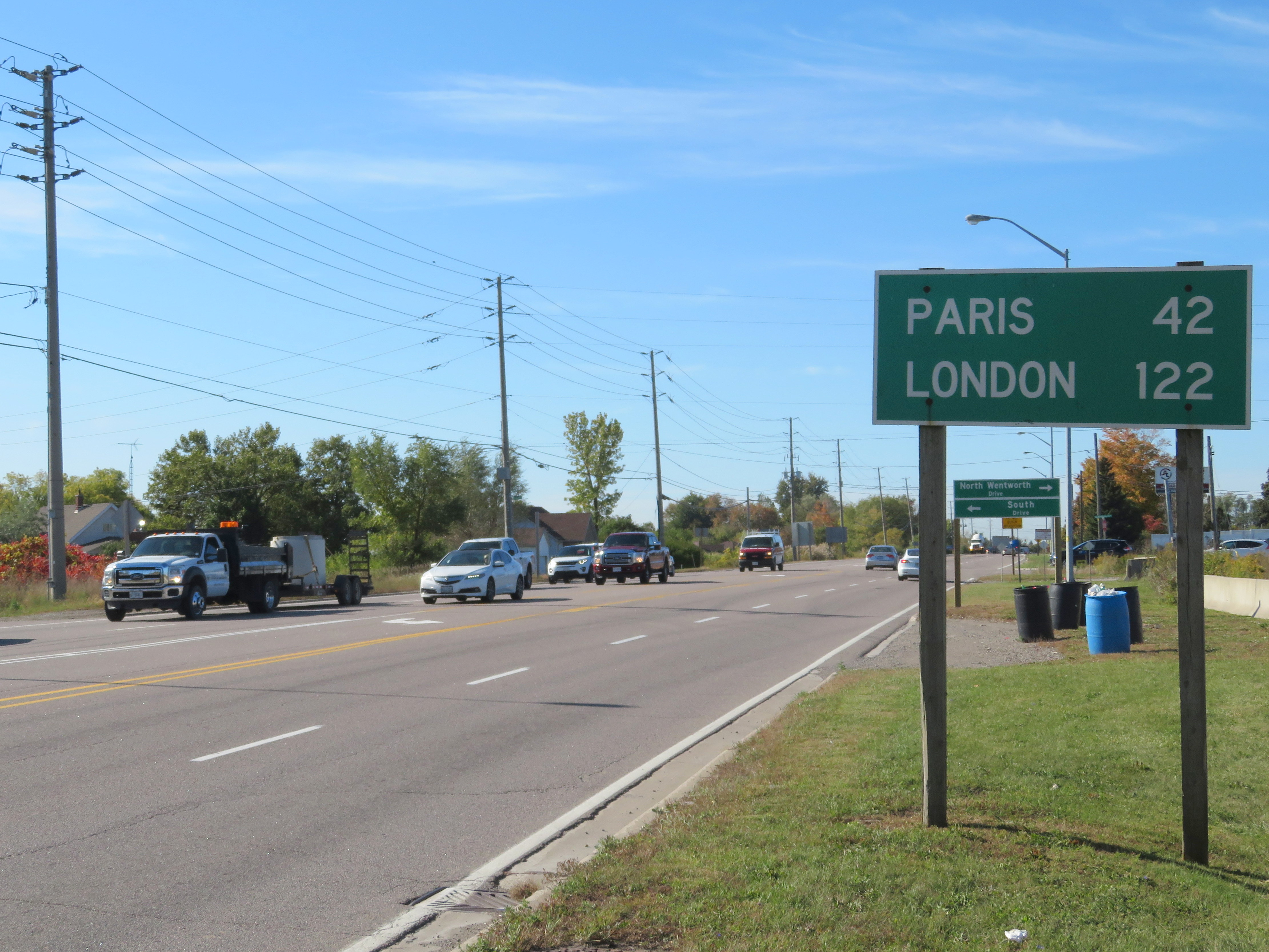 Sign with the distance to Paris and London Ontario