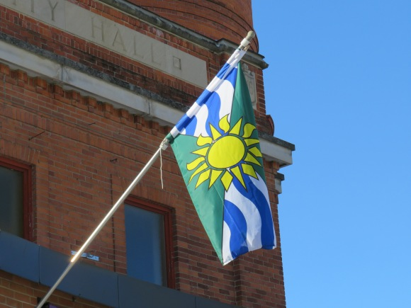 Orillia municipal flag, with a yellow sun in the middle
