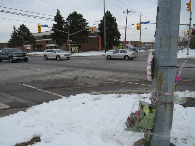 The intersection of Alness and Supertest, with a makeshift memorial on the southwest corner